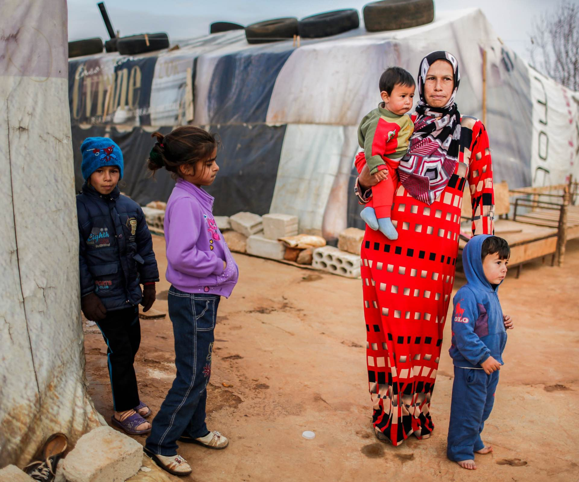 kids and mother at refugee camp Migrants and Refugees