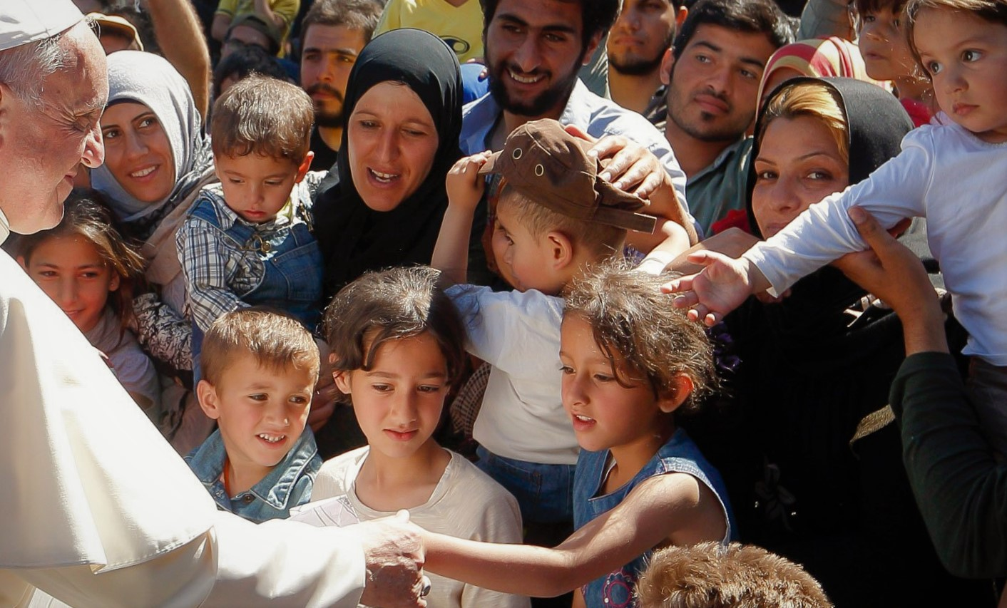 pope francis with refugees Migrants and Refugees