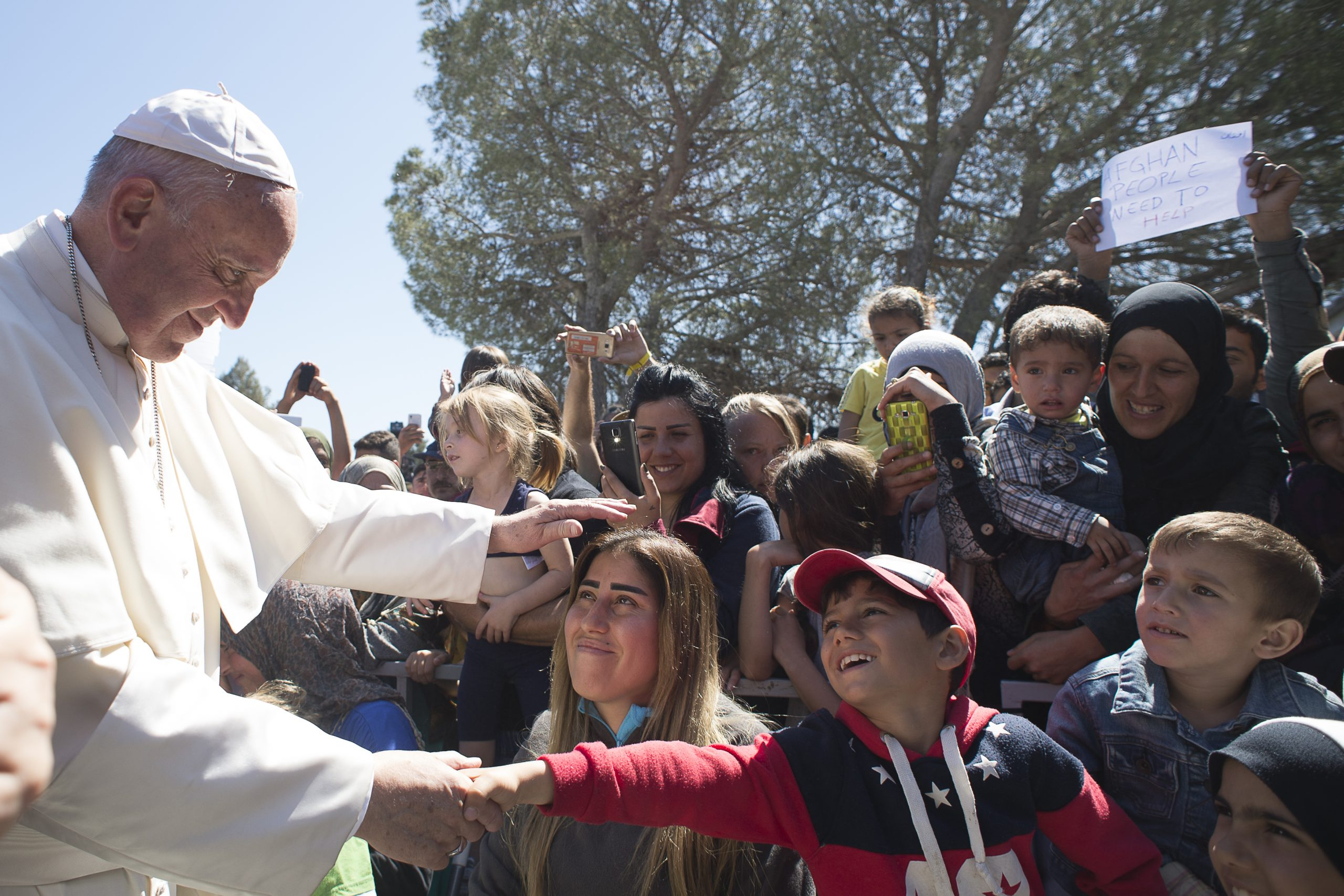 Pope Francis with Migrants Migrants and Refugees